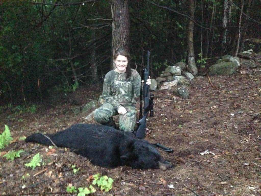 Erin Reed poses with her first bear